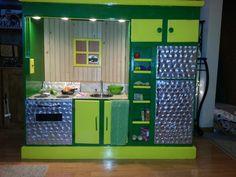 Repurposed entertainment center turned john deere kitchen.