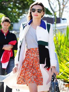 Miranda Kerr switches out a typical high-waisted skirt with a bright floral print skirt. // #OutfitIdeas