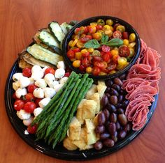 Large Antipasto Platter - done for a catering. Heirloom tomato salad, grilled veggies, capri salad, salami, olives and marinated artichokes. feeds 25 - 30