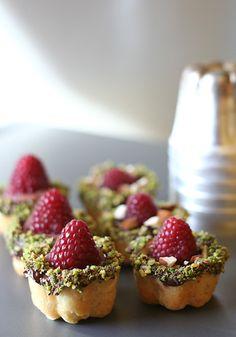 Raspberry and chocolate ganache tarts.