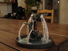 A fountain model with statues