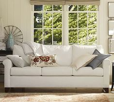 Like this couch (the 3 cushions appeal) -- will prob want a darker color and a kid friendly fabric