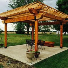 This image features a patio pergola made with the Post Base Kit, Post to Beam Bolt Brackets, and Rafter Clips by OZCO Ornamental Wood Ties