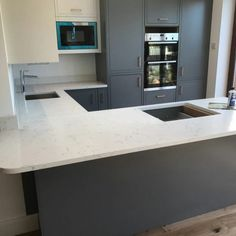 Choosing the perfect handles for your hub of the home - Rock and Co Granite Ltd Marble Quartz, White Quartz, Compact Kitchen, Granite, Door Handles, Kitchen Cabinets, Design Inspiration, Carrara, Contemporary