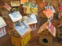 little house pendants.  These would make cute Christmas ornaments.