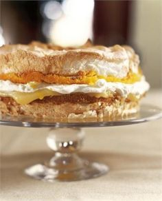 Lemon  Meringue Cake ~ layers of meringue, sandwiched with tart lemon curd and softly whipped cream