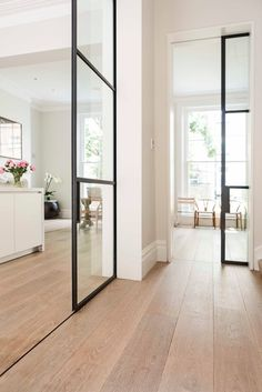 Home Decoration Ideas For Christmas black framed pocket doors 15 Magical Pocket Doors For Your Small Space.Home Decoration Ideas For Christmas black framed pocket doors 15 Magical Pocket Doors For Your Small Space Home Interior Design, Interior And Exterior, Interior Walls, Black Interior Doors, Farmhouse Interior, Modern Farmhouse, Style At Home, White Oak Floors, Wooden Flooring