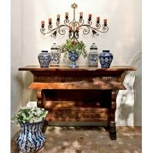The homeowners call this hand-carved piece an altar table because it reminds them of ones used in the Mexican Catholic culture. Talavera vases adorn its top; the candelabra was purchased in Guadalajara 50 years ago by John Taber's mother.