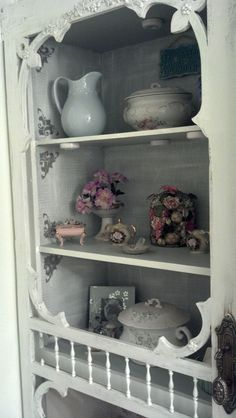 Old screen door in place of Bathroom cabinets to display antiques.