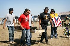Pallbearers carried Albert Afraid of Hawk's remains at a South Dakota reservation. He died in 1900 in Danbury, Conn.  Descendants of a Native American man who died more than a century ago while touring with Buffalo Bill's wild west show gathered together Sunday to honor his life and celebrate his remains coming home to a South Dakota reservation.