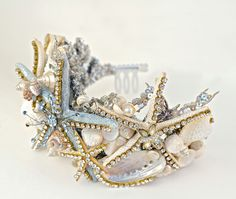 Use a dollar store crown and thrift store costume jewelry to DIY a mermaid tiara for Halloween.