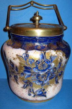 One of Carlton Ware's famous early Victorian Biscuit Barrels in a richly gilt outlined decoration with flow blue flowers. Biscuits, Carlton Ware, Pickle Jars, Vintage Cookies, Biscuit Cookies, Vintage Tins, Chocolate Pots, Bottles And Jars, Porcelain Ceramics