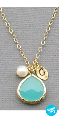 This delicate personalized turquoise pendant necklace looks amazing as a pop of color to a neutral outfit and makes for a thoughtful gift for the holidays. It features a Swarovski pearl, a turquoise bezel glass pendant and an intricate leaf charm with the initial of your choice. Plus, it comes in 14K gold or sterling silver and in a gift box ready to give.