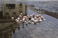 Politicians discussing global warming. Sculpture by Issac Cordal in Berlin