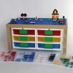 There's a place for every brick. Here are 15 cool and functional ways to organize LEGO range from a DIY LEGO table LEGO storage ideas that include bins from The Container Store. Lego Storage, Storage Ideas, Kids Play Table, Lego Table, Lego Modular, Lego House, Drawer Organisers, Toy Organization, Lego Brick