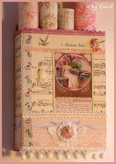 This was a simple cornflakes box before she collaged it and made it into a wall box to store wallpapers, ledgers and such