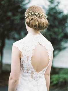 Rolled chignon adorned with baby's breath | Photo by Krista A. Jones