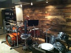 Another Paul Charron Drums studio photo with pallet board wall.