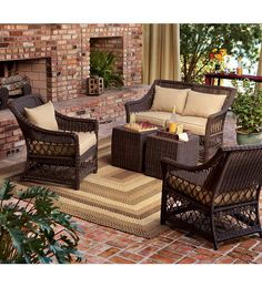 Relax in cushioned comfort in this Somerset 5 Piece Outdoor Wicker Seating Set. Wicker is woven onto an aluminum frame durable enough for the outdoors, made extra luxurious with olefin cushions in a neutral camel that looks great in any setting: patio, deck or sunroom.