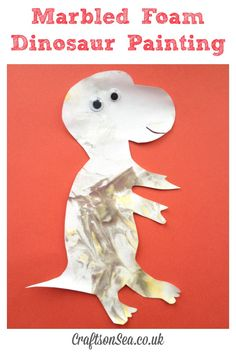 dinosaur messy play painting using marbled foam