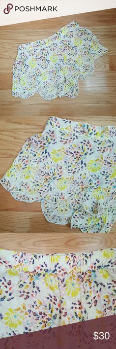 Intimately Free People Shorts Fun colorful floral print shorts with a delicate scalloped hemline and eyelet cutout details. These are unlined and sheer. Could be worn as a bathing suit cover up, or as regular shorts if you throw a pair of bloomers underneath. Small pin size hole where a sensor was removed near upper left as seen in 4th photo. Free People Shorts