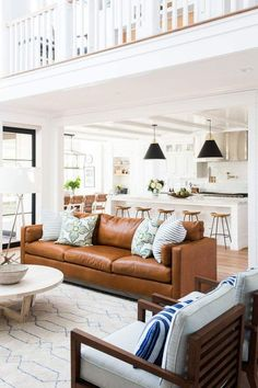 Living room design. Brown leather couch. Home decor