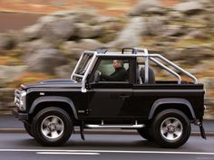 Land Rover Defender SVX. My dream car! A land rover and jeep mated and produced this. It's beautiful.