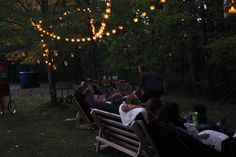 For soft lighting around the seating area we purchased wicker ball string lights from Target at $10 a strand and did about 10 strands through the trees.  I did sling PB some business last  year and bought those mason jar lanterns.