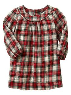 Plaid dress, this with black tights and little baby boots.  Makes for a twist on a classic winter look.