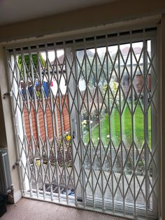 Retractable Security Door Grilles fitted internally to the main entrance of the living room of a residential complex in Fulham Window Security Bars, Security Screen, Security Doors, Door Design, House Design, Grill Gate, Burglar Bars, Balcony Grill Design, Window Grill