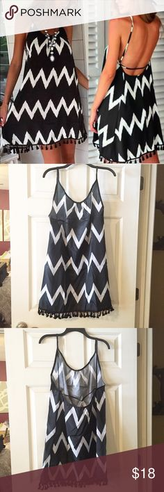 Swim Cover - Black and White Chevron NWOT swim cover! Black and White chevron with a fringe hemline. Bought this with plans to wear it, but I just don't have time to be at the lake. My loss your gain! There's no label other than a size label so I can't say what the material is. Swim Coverups