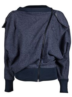 Opium cardigan in blue from Vivienne Westwood Anglomania. This cotton knit cardigan sweater features a boat neck, off-set exposed zipper closure, long extreme dolman sleeves, and a flap pocket at left shoulder. Has tapered hem , with rib knit band at cuffs and hem.