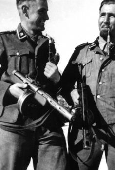 Two Waffen SS, from 'Totenkopf' Div. with Russian PPSH machine guns, eastern front WWII.