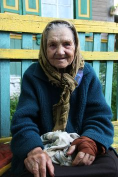 Life in the Exclusion Zone 3.  This granny used to be Miss Bartolomeevka – 1937! Today she continues to work in the garden and milk her goat.