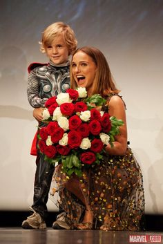 This is just... awww! Natalie Portman (Jane Foster) & a young fan dressed as Thor at the Paris premiere of Marvel's Thor: The Dark World