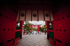Looking back out from within Fushimi Inara in Kyoto, Japan.  Impeccable doors and perfect gates (a lot of them).