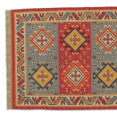 HERALDIC WOOL DHURRIE -- Stylized crosses give our flatweave rug a medieval air, interpreted in strong shades of red and orange, cooled by sand and gray. Handwoven with wool weft and cotton warp for added durability. Imported exclusively for Sundance. Five sizes available: 2-1/2W x 8L