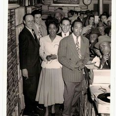 Charlie Parker with Sarah Vaughan and Red Rodney in the background.