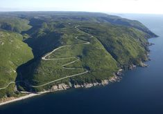 The Cabot Trail on Cape Breton Island, Nova Scotia, Canada. You can take an overnight ferry from here to Newfoundland. The scenery is reminiscent of Ireland and Norway, and the two lands may be been connected at one time. Cabot Trail, Nova Scotia, Places To Travel, Places To See, Cap Breton, Quebec, Alaska, Atlantic Canada, Canada Travel