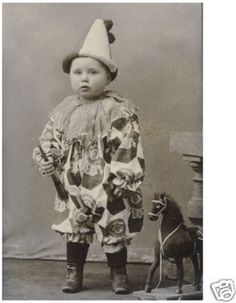 Little boy in a clown costume, c. 1910.