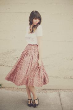 I absolutely love the idea of a really full light pink skirt with a casual tee. It's so feminine.
