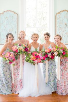 Stunning bouquets by Meristem Floral in the Raleigh/Durham area. Love the very different bridesmaids gowns too!