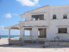 An abandoned beach house awaits demolition.