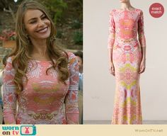 Gloria's pink mirrored print maxi dress at the wedding on Modern Family.  Outfit Details: http://wornontv.net/32599/ #ModernFamily