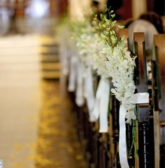 white orchid Wedding aisle flower décor, wedding ceremony flowers, pew flowers, wedding flowers, add pic source on comment and we will update it. www.myfloweraffair.com can create this beautiful wedding flower look.