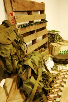 "Grab a pallet and some army backpacks for the table. Army dudes from dollar tree. Army surplus for a few odds & ends. This is where drinks, cake & ""survival kits"" will be for the kids. Nothing too big of a deal. Just 5 kids so keep it real. keep it small. But keep it COOL!"