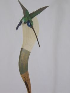 Studio Spirit hummingbird carved artist, David Caricato featured at Spirits in the Wind Gallery Golden, CO