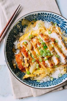 Katsudon - A fried, panko-breaded pork cutlet with egg over rice.
