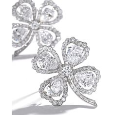 PAIR OF PLATINUM AND DIAMOND CLOVER BROOCHES, VAN CLEEF & ARPELS, NEW YORK, CIRCA 1950, Set with 8 pear-shaped diamonds weighing 3.54, 3.21, 2.97, 2.91, 2.91, 2.87, 2.75, and 2.48 carats, accented by round diamonds weighing approximately 8.70 carats, and baguette diamonds weighing approximately .70 carat, signed Van Cleef & Arpels, numbered N.Y. 12208 and N.Y. 9981.