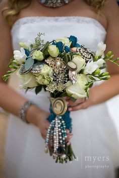 Unique broach bouquet with blue flowers. www.flourla.com Loved what you did to this for Kristen's Wedding Carly!